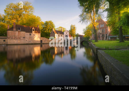 City canal at sunrise, Bruges, West Flanders, Belgium - Stock Image