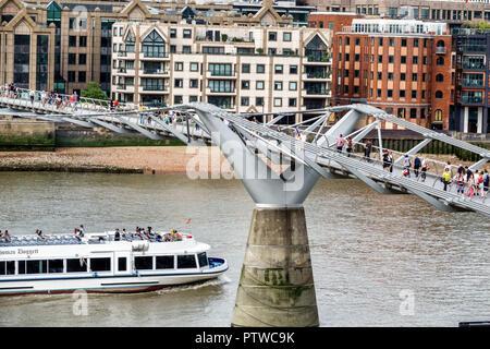 London England United Kingdom Great Britain Tate Modern art museum view River Thames Millennium Bridge suspension footbridge pedestrians crossing brid - Stock Image