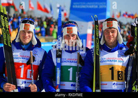 Krasnoyarsk, Russia. 09th Mar, 2019. KRASNOYARSK, RUSSIA - MARCH 9, 2019: Skiers Ivan Kirillov, Anton Timashov, and Kirill Kilivnyuk (L-R) of Russia pose for a photo after winning the men's 4x7, 5 men's cross-country skiing relay race at the 2019 Winter Universiade. Vladimir Smirnov/TASS Credit: ITAR-TASS News Agency/Alamy Live News - Stock Image
