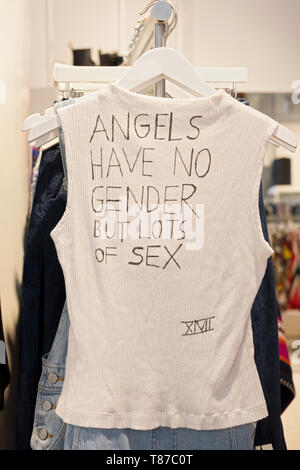 A sleeveless t shirt for sale saying 'ANGELS HAVE NO GENDER BUT LOTS OF SEX' at Phluid, a gender-free store in Greenwich Village, new York City. - Stock Image