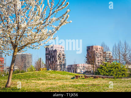 Bologna Quartiere Navile in Italy with Trilogia Navile modern building city park in spring - Stock Image