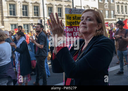 London, UK. 13th October 2018.   Emma Dent-Coad MP applauds at the rally in London to oppose racism  and fascism close to where the racist, Islamophobic DFLA were ending their march on Whitehall bringing together various groups to stand in solidarity with the communities the DFLA attacks. The event was organised by Stand Up To Racism and Unite Against Fascism. Peter Marshall/Alamy Live News - Stock Image
