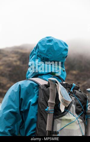 Walker in waterproofs - Stock Image