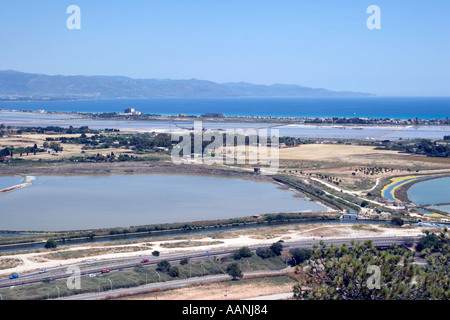 Cagliari Salt Flats Sardinia   flat salt pan shallow lagoon Devil s Saddle Sella del Diavolo landscape  rural costal travel - Stock Image
