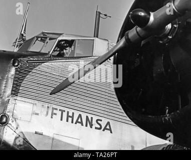 A Lufthansa pilot in the cockpit of a Junkers Ju 52 / 3m. - Stock Image