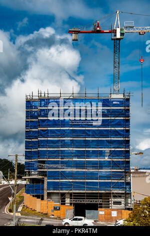 Gosford, New South Wales, Australia - September 5. 2018: Construction and building progress update 132. A working tower crane on new home units buildi - Stock Image