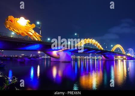 The Dragon Bridge (Cau Rong) illuminated at night, Da Nang, Vietnam - Stock Image