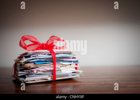 Stack of letters tied together with ribbon - Stock Image
