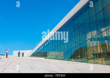 Oslo Opera House, view in summer of a tourist taking a photo on the vast access ramp leading to the roof of the Oslo Opera House, Norway. - Stock Image