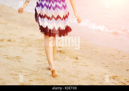 Asian woman runing on beach - Stock Image