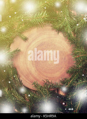 Christmas tree on a wooden background, top view, with space for text. toning, bokeh effect - Stock Image