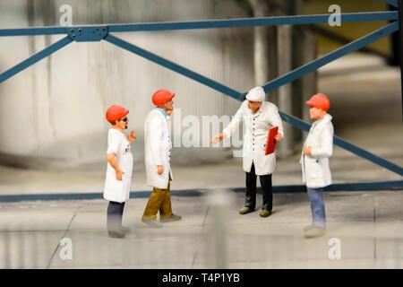 Miniature model of industrial workers at Kolejkowo, Wrocław, Wroclaw, Wroklaw, Poland - Stock Image