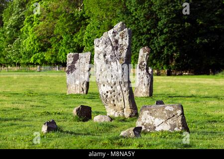 Cup and ring marks on south face of central stone of Nether Largie standing stones. Prehistoric rock art in Kilmartin - Stock Image