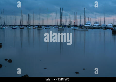 Yachts at Puerto del Buceo (Buceo Port) during cloudy evening, Bahia del Buceo (Buceo Bay), Montevideo, Uruguay. Long exposure shoot - Stock Image