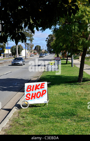 'Bike Shop' and other commercial road-side signs. Guildford, Perth, Western Australia - Stock Image