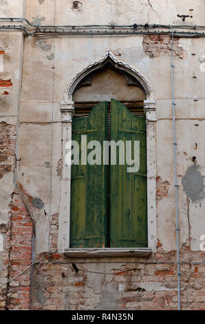 Old Venetian shutters in Venice Italy - Stock Image
