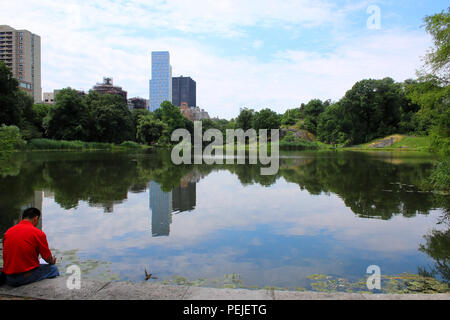 South view on Harlem Meer in Northern Central Park, Manhattan on JULY 4th, 2017 in New York, USA. (Photo by Wojciech Migda) - Stock Image
