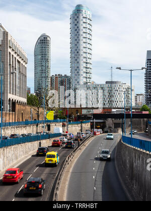 London, England, UK - June 1, 2019: Traffic flows on the Blackwall Tunnel approach road under new build high rise apartment buildings in the Docklands - Stock Image