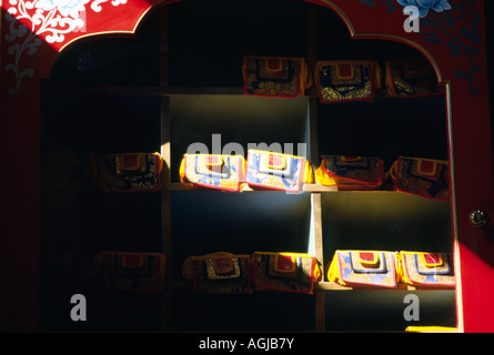 Wooden Tibetan Buddhist Prayer books in a monastery cabinet Om Mani Padme Houng - Stock Image