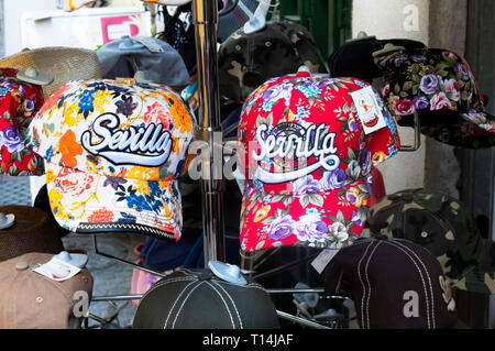 Seville baseball style caps for sale as souvenirs - Stock Image