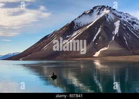 Greenland. Kong Oscar Fjord. Dream Bay. Zodiac on still water. - Stock Image