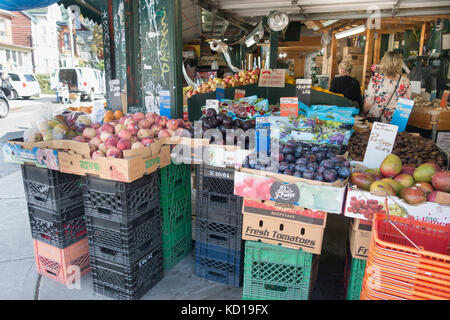 Fruit for sale outside store in Kensington Market in downtown Toronto, Ontario, Canada - Stock Image