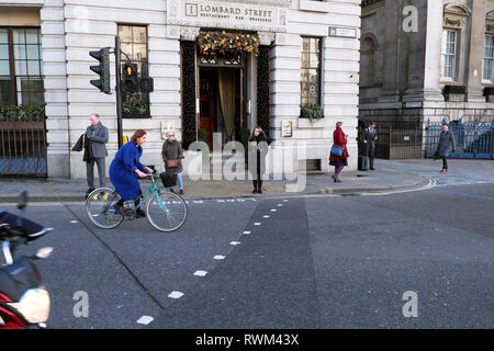 Lombard Street restaurant exterior view of front entrance and people walking in the street in the City of London EC2  ENGLAND UK  KATHY DEWITT - Stock Image