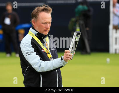 Portrush, Country Antrim, Northern Ireland. 17th July, 2019. The 148th Open Golf Championship, Royal Portrush Golf Club, Practice day; leading putting coach Phil Kenyon studying the slopes on the practice green with a spirit level Credit: Action Plus Sports Images/Alamy Live News - Stock Image