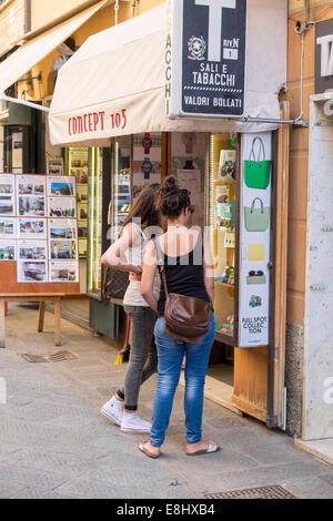 Two young women looking at a shop window, Sestri Levante, Liguria, Italy - Stock Image