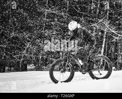 Fatbiking at Mont Sainte Anne in Quebec, Canada - Stock Image