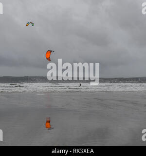 Marazion, Cornwall, UK. 9th Feb 2019. UK Weather. Kite surfers were out this afternoon, making the most of the strong winds brought on by storm Erik. Credit: Simon Maycock/Alamy Live News - Stock Image