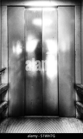 Silouette of a man taking the lift. - Stock Image