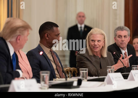 CEO of IBM, Ginni Rometty, right, speaks during the American Workforce Policy Advisory Board Meeting chaired by U.S President Donald Trump, left, in the State Dining Room of the White House March 6, 2019 in Washington, DC. - Stock Image