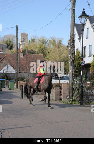 lady riding her horse in the small sussex village of bramber west sussex - Stock Image