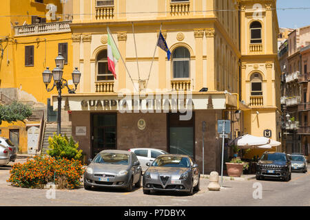Italy Sicily Agrigento old town Guardia di Finanza government guard agency combatting drugs & financial crimes flags Italian EEC parked cars - Stock Image