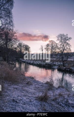Cold winters day at dawn on the banks of the River Dee, Aberdeenshire, Scotland, UK. - Stock Image