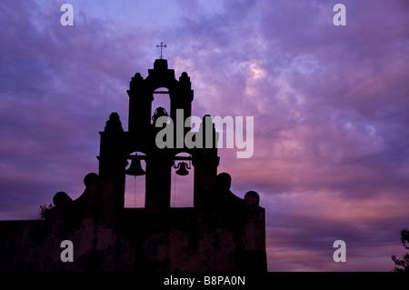 Mission San Juan Antonio bell tower san juan antonio texas tx early morning dramatic blue sky - Stock Image