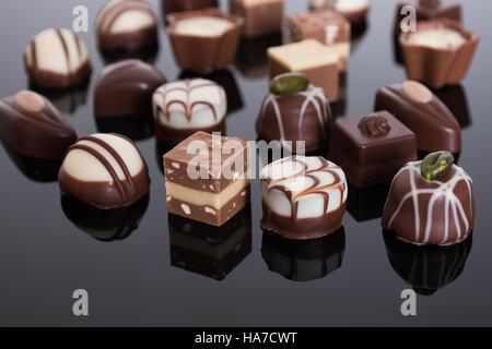 An assortment of fine chocolates in white, dark, and milk chocolate - Stock Image
