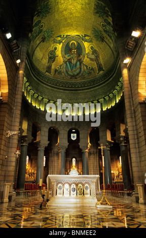 The interior of Monaco Cathedral, focussing on the altar and golden ceiling mosaic. - Stock Image