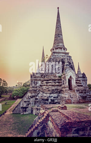 Vintage style add texture effect, ancient ruins and pagoda of Wat Phra Si Sanphet old temple famous attractions - Stock Image