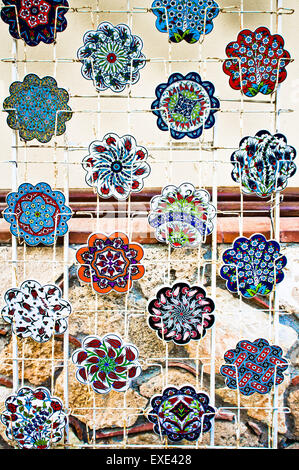 Ceramic souvenir coasters on sale at a store in Turkey - Stock Image