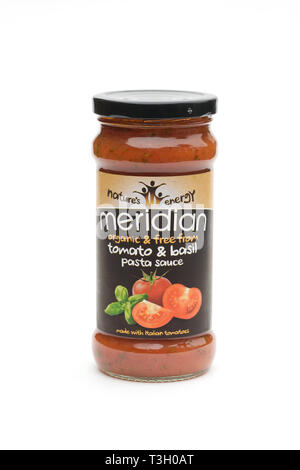 Meridian Tomato and Basil Pasta Sauce on a white background. - Stock Image