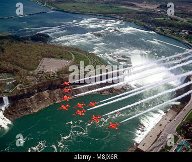 The Red Arrows  ( the Aerobatic display team of the Royal Air Force), overflying Niagara Falls, Canada - Stock Image