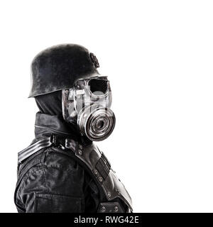 Close-up portrait of a futuristic Nazi soldier wearing gas mask. - Stock Image