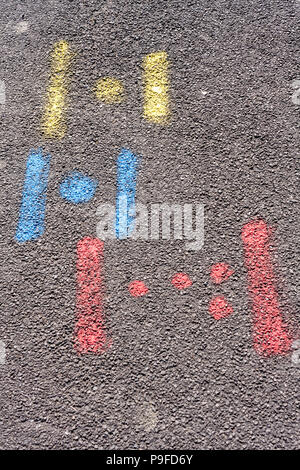 Spray painted markings left on road by contractors to indicate positioning of water, gas and electric utilities. - Stock Image