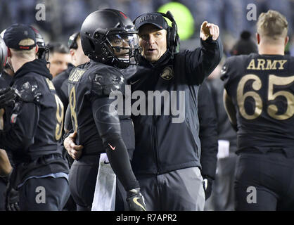Philadelphia, Pennsylvania, USA. 8th Dec, 2018. Army's head coach, JEFF MONKEN, talks to his QB, KELVIN HOPKINS, during the game against Navy at the 119 meeting of the Army Navy game at Lincoln Financial Field in Philadelphia PA Credit: Ricky Fitchett/ZUMA Wire/Alamy Live News - Stock Image