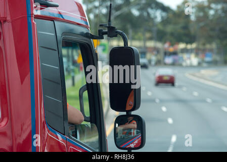 A driver's height point of view of a semi trailer prime mover truck cab driving on a main road in Sydney Australia - Stock Image