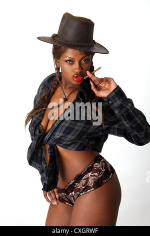 Black Girl Wearing a Cowboy Hat, Tied Checked Shirt and Shorts. - Stock Image
