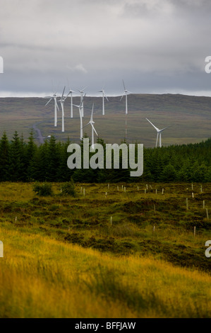 photograph of wind turbines next to forest on isle of skye - Stock Image
