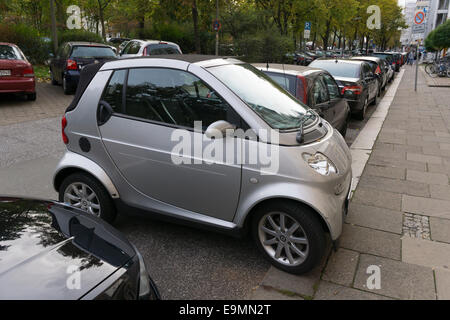 Smart car parking across the parking direction. - Stock Image